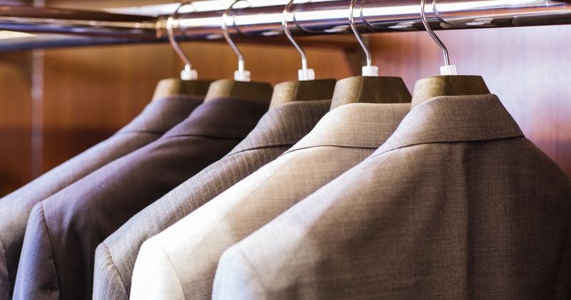 Suit coats hanging on a coat rack
